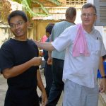 Ker Muntit of AP takes a pat on the back from former boss and owner of the Phnom Post, Michael Hayes, in Phnom Penh Cambodia.