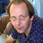 Photographer and travel writer Dan White, Christmas at the AFP house in Phnom penh, 2003.
