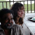 Film maker Paul Roy with daughter Ellie by the Mekong River.
