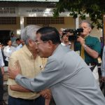 Cambodian Prime Minister Hun Sen shakes hands with old friend Benny Widyono during the 2008n election. James Gerrand and Reach Sambath are in the background.