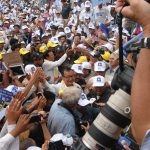 Opposition leader Sam Rainsy campaigning ahead of elections in 2013.