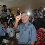Cambodian Prime Minister Hun Sen votes in the 2013 elections.