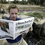 Luke Hunt in Baghdad following the 2003 US invasion of Iraq reads a copy of the Phnom Penh Post.