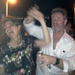Luke Hunt dances with Kate Bartlett aboard an OPCC booze cruise in 2013.